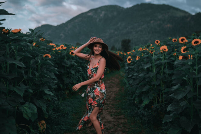 A woman poses in a field of sunflowers at the Chilliwack Sunflower Festival