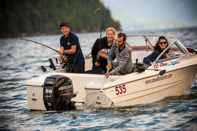 People fish from a boat in Howe Sound Near Vancouver